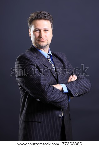 Closeup of a smiling senior man isolated over black background - stock photo