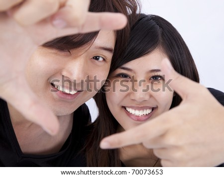 Closeup of a smiling young woman and man - stock photo