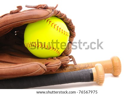 Closeup of a Softball Glove ball and two bats on white with copy space. Horizontal format. - stock photo