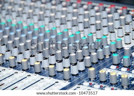 closeup of a sound control mixer - stock photo