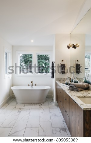 Closeup of a spacious modern bathroom, bright and airy