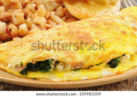 Closeup of a spinach and feta cheese omelet - stock photo