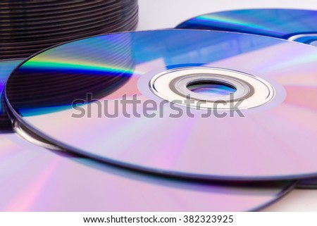 Closeup of a stack compact discs (CD/DVD) - stock photo