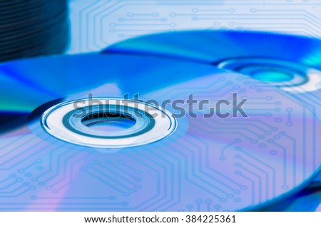 Closeup of a stack compact discs (CD/DVD) with the circuit board - stock photo