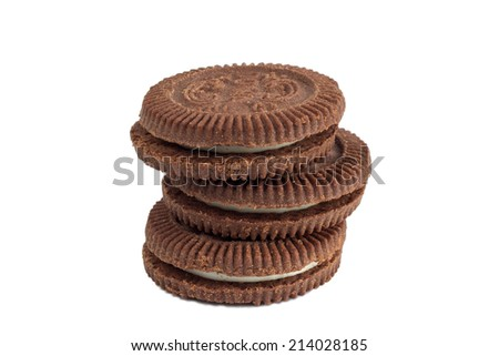Closeup of a stack of chocolate cookies with white filling, isolated on white background - stock photo