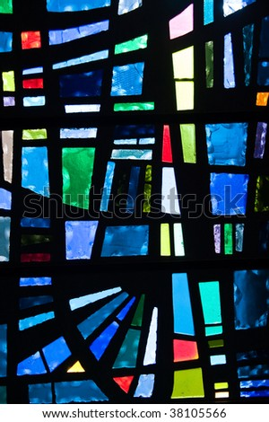 Closeup of a stained glass window panel - stock photo