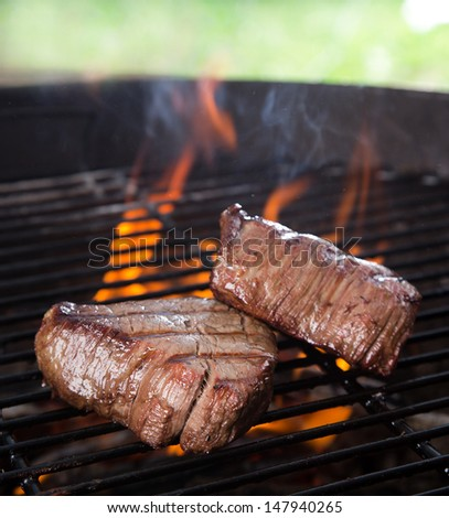 closeup of a steak on grill - stock photo