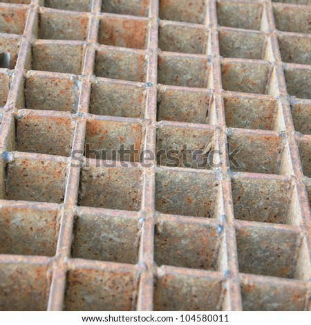 Closeup of a steel grate - stock photo