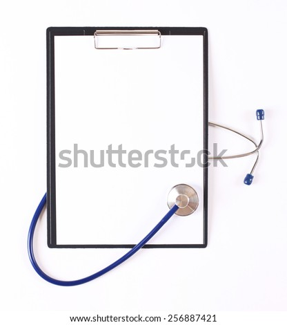 Closeup of a stethoscope on a clip folder - stock photo