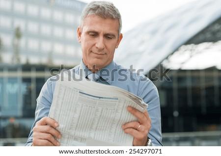Closeup Of A Stockbroker Reading Stock Price - stock photo