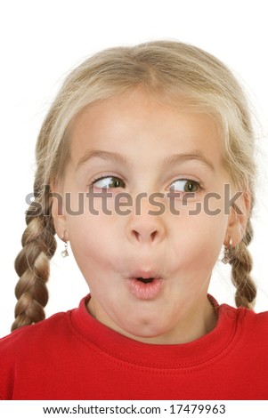 Closeup of a surprised little girl looking away - stock photo