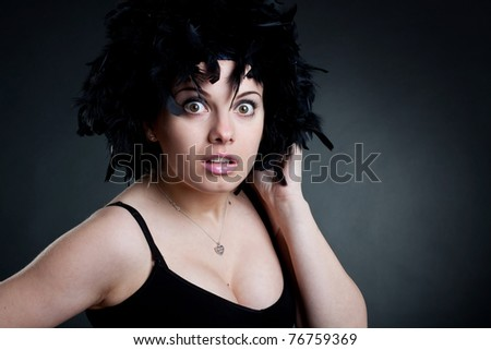 Closeup of a surprised woman with a black wig - stock photo