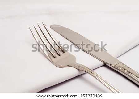 Closeup of a table with a knife and fork - stock photo