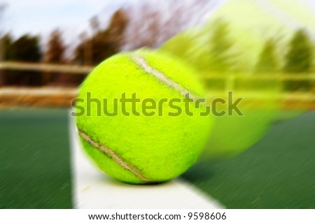 Closeup of a tennis ball on the boundary line - stock photo