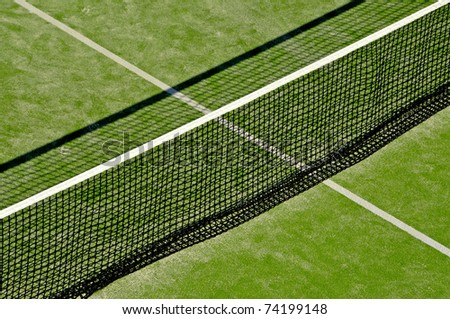 closeup of a tennis court with the net at the front - stock photo