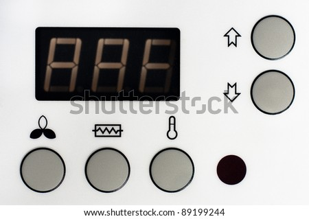 Closeup of a thermostat with big buttons and display - stock photo