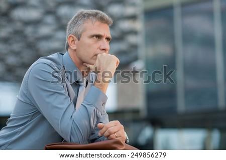 Closeup Of A Thoughtful Mature Businessman Outdoor - stock photo