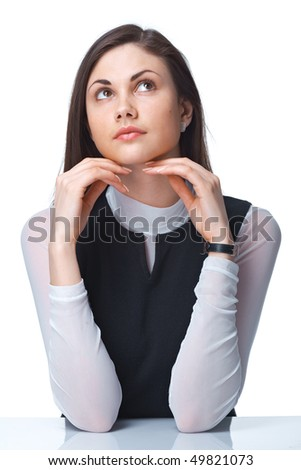 Closeup of a thoughtful young woman looking up over white background - stock photo