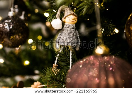 Closeup of a toy -  beautiful hand-made christmas tree decorations made for New Year celebration - stock photo
