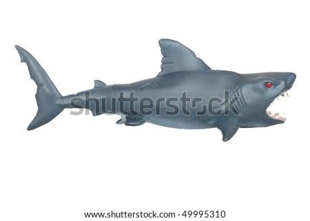 Closeup of a toy rubber shark on white background - stock photo