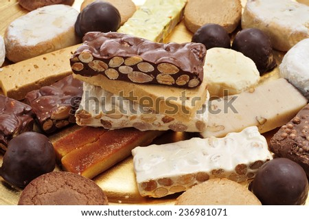 closeup of a tray with different turron, polvorones and mantecados, typical christmas confections in Spain