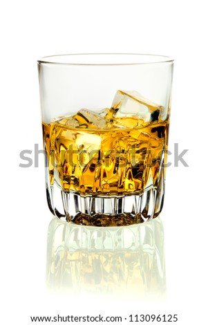 Closeup of a tumbler of glowing golden brandy and ice on a white background with relection