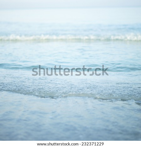 Closeup of a turquoise tropical wave - stock photo