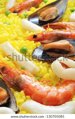 closeup of a typical paella from Spain, with mussels and prawns