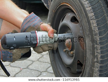 closeup of a tyre change - stock photo