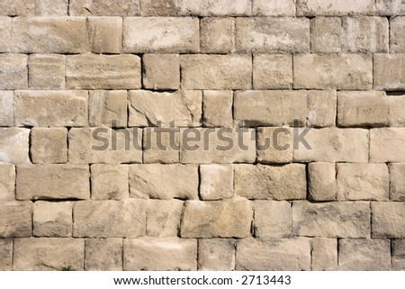 Closeup of a very old stone wall - stock photo
