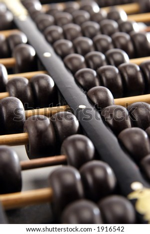Closeup of a vintage abacus. Shallow depth of field.