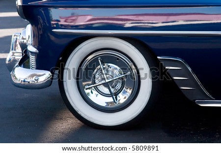 Closeup of a Vintage Care Fender and Tire - stock photo