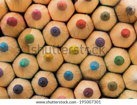 closeup of a wall of colorful pencils - stock photo