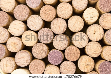 Closeup of a wall of used wine corks. A random selection of used wine corks, some with vintage years. Horizontal format that fills the frame. - stock photo
