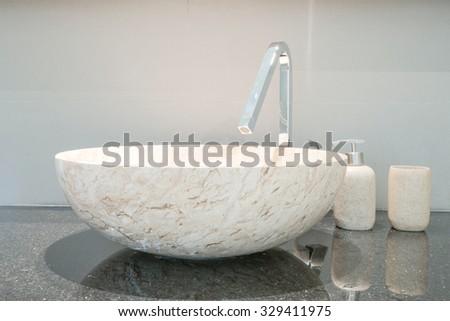 Closeup of a wash basin in a modern bathroom - stock photo