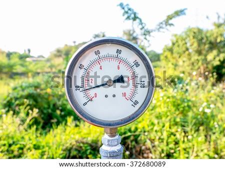 Closeup of a water gauge,Water meter - stock photo