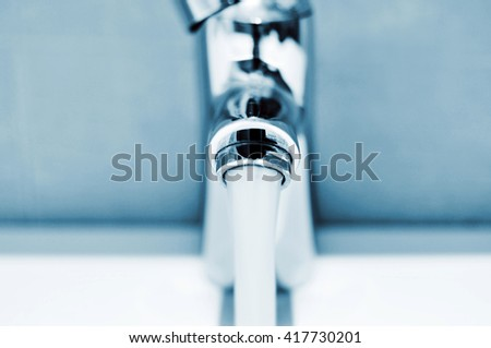 closeup of a water running from a faucet