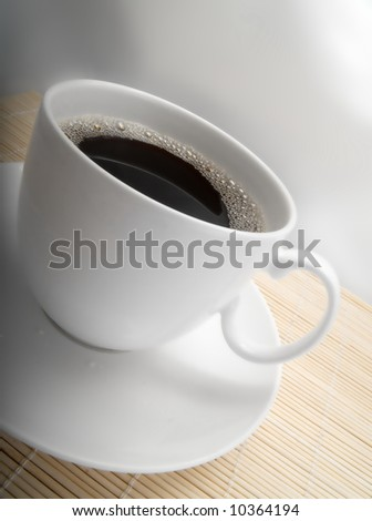 Closeup of a white coffee cup - stock photo