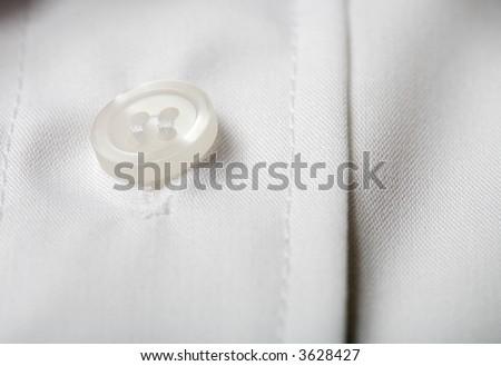 Closeup of a white dress shirt - stock photo