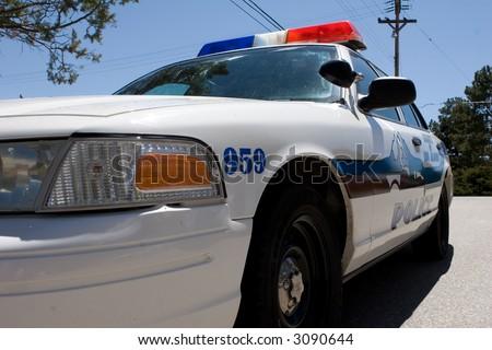 closeup of a white police cruiser - stock photo