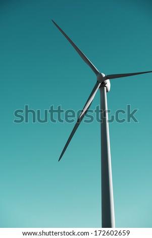 closeup of a windmill for renewable electric energy production, Pozuelo de Aragon, Zaragoza, Aragon, Spain. - stock photo