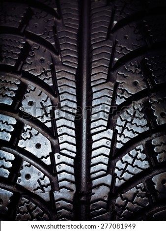 Closeup of a winter snow tire tread - stock photo