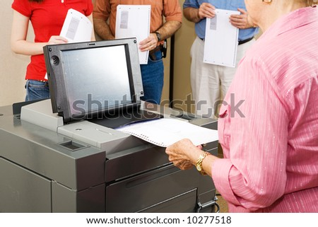 Closeup of a woman feeding her ballot into Florida's new optical scanner machine.