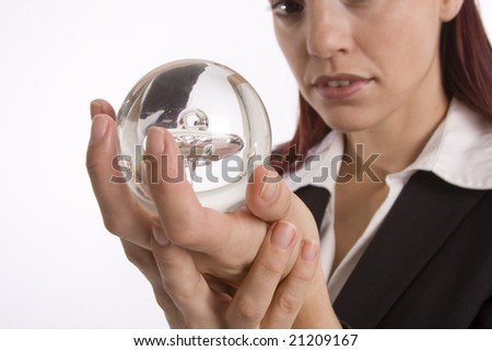Closeup of a woman hands holding a crystal ball with face slightly out of focus - stock photo
