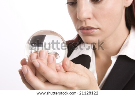 Closeup of a woman holding a crystal ball in her hand - stock photo
