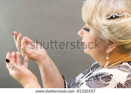 Closeup of a woman holding a crystal balls in her hands - stock photo