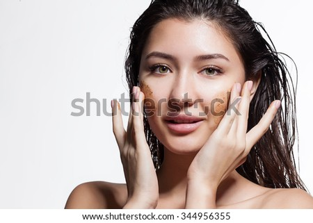 Closeup of a woman making a face peeling scrub - stock photo