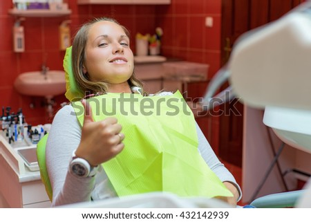 Closeup of a woman patient at the dentist waiting to be checked up