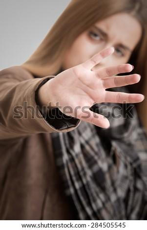 Closeup of a woman protecting herself from an aggressor - stock photo