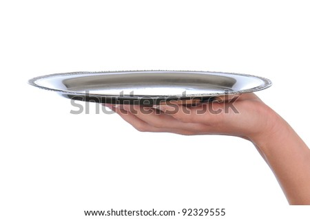 Closeup of a woman's hand holding up a silver serving tray over a white background.